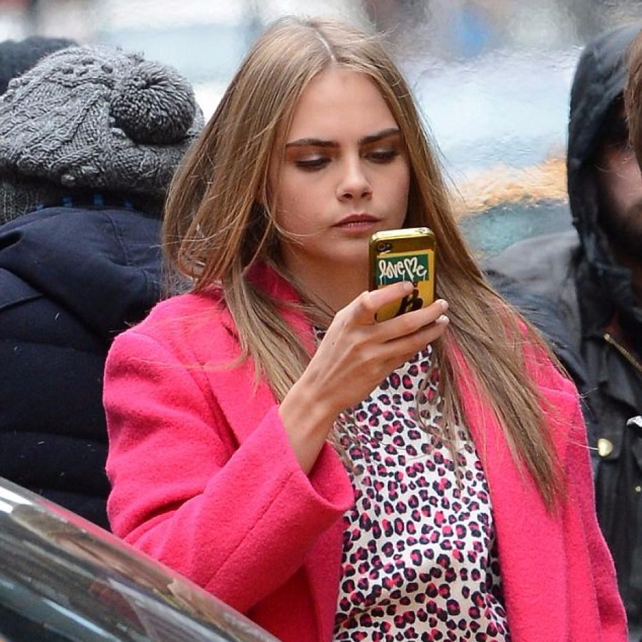 cara delavigne on phone